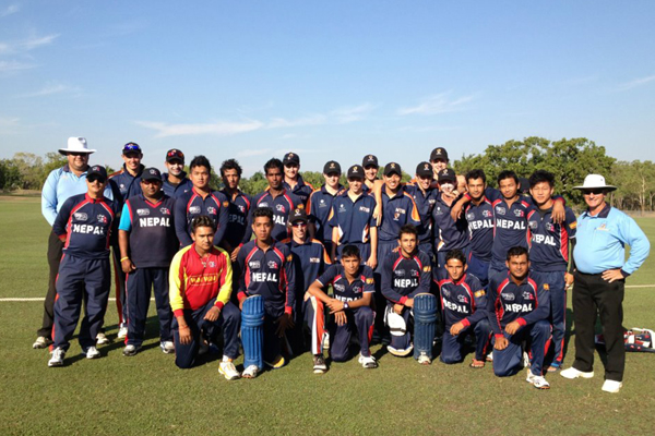 Nepal U19 with NT Top End Invitational Academy and officials pose for a photo after the practice match. Photo: NT Cricket