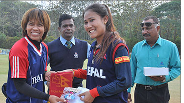 Nepal skipper Rubina Chhetry with her opposite number in the ACC Women's Championships 2013