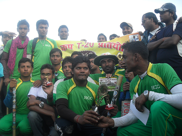 Players of Kumharauda Cricket Club with the Janaki Trophy after Beating the organizes Janaki Coaching Center in the final